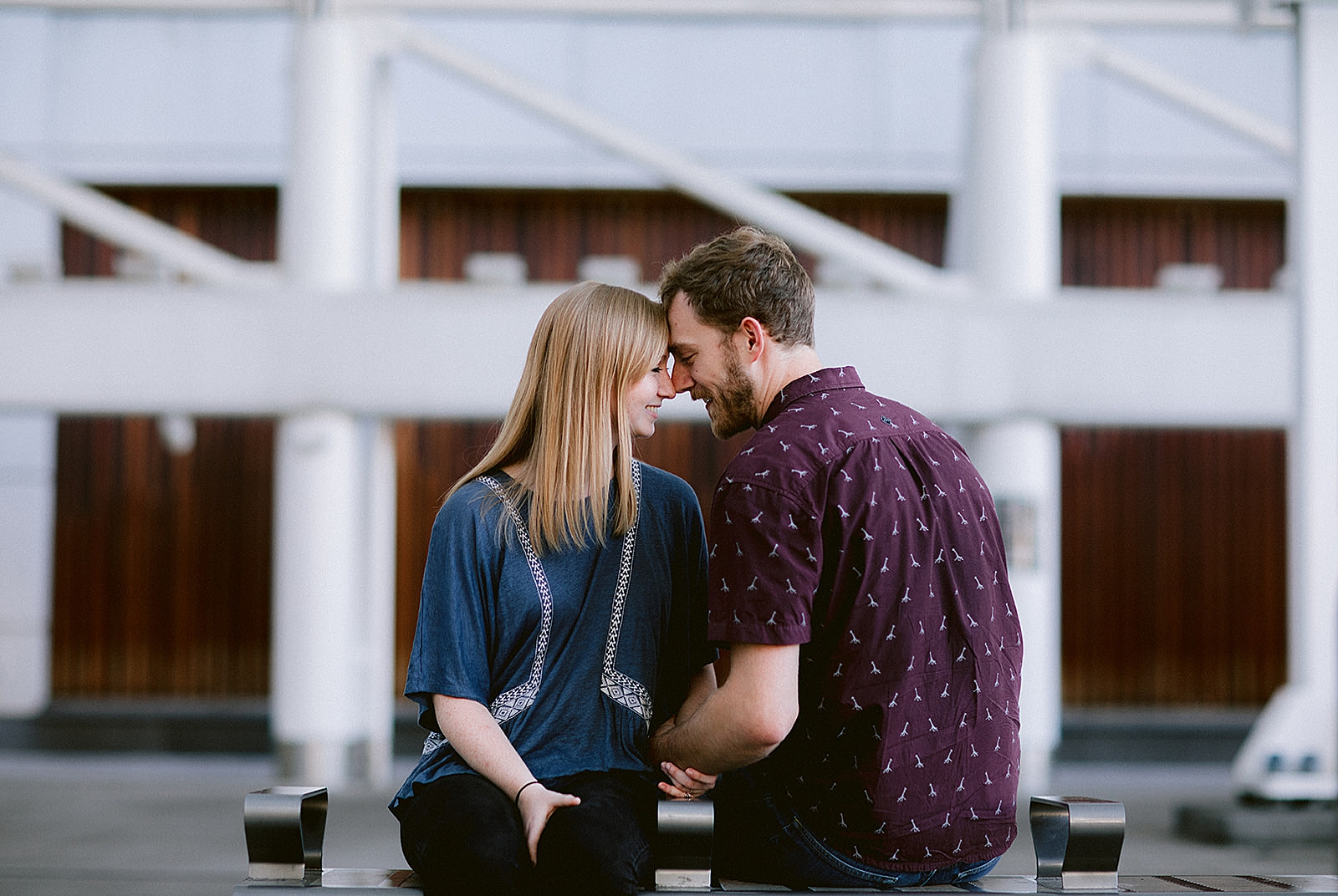 Couple smiling and sitting Downtown Denver Engagement Photos by Matthew Speck