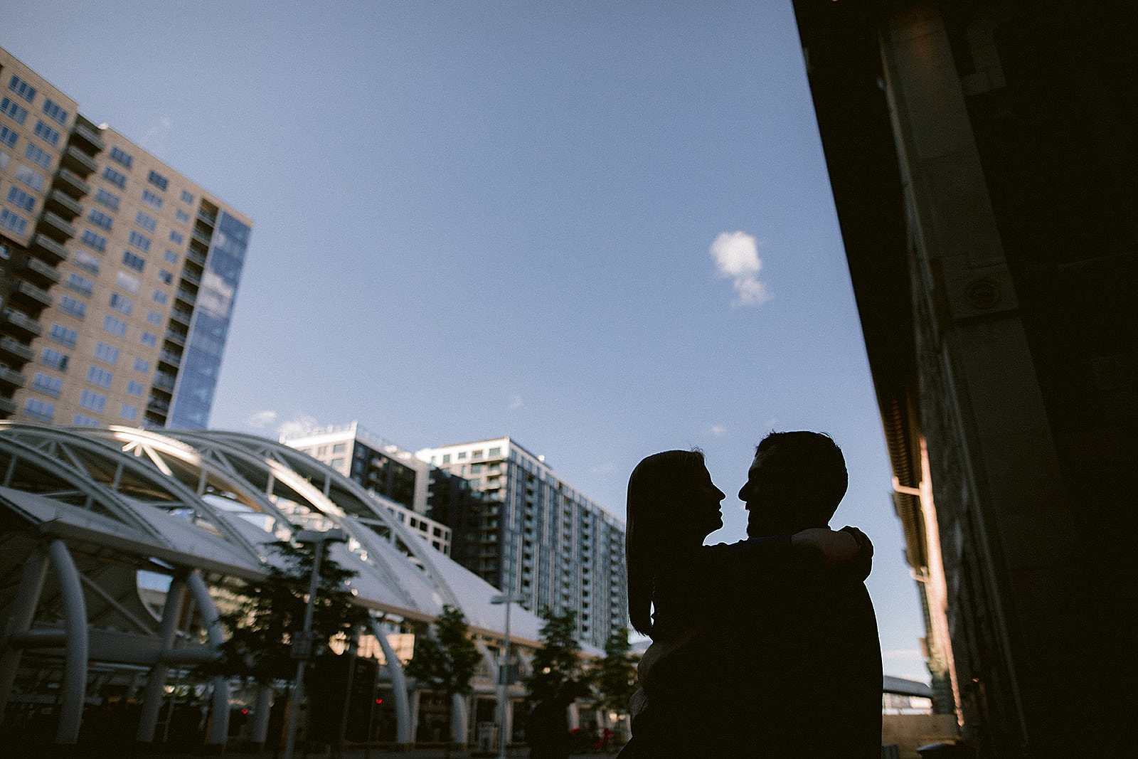 Backlit couple embracing Downtown Denver Engagement Photos by Matthew Speck