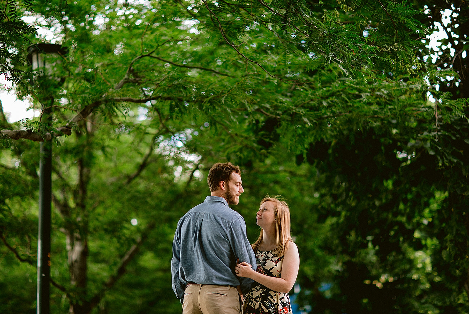 Couple in park Downtown Denver Engagement Photos by Matthew Speck