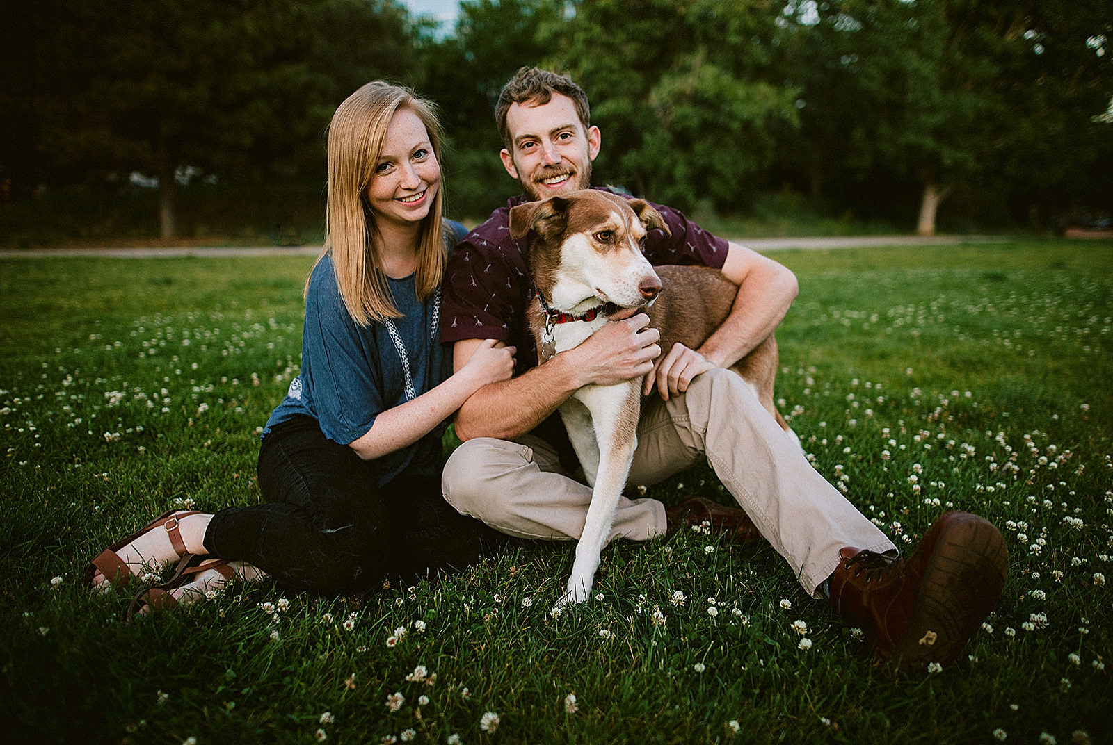 Couple in park with dog Downtown Denver Engagement Photos by Matthew Speck