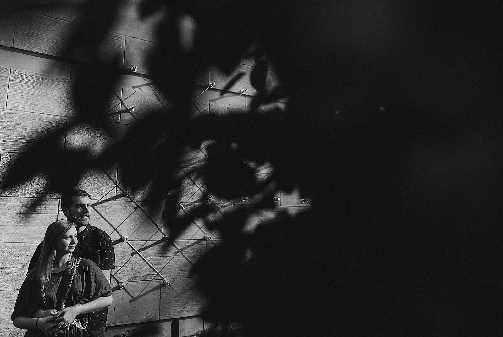 Couple hugging in black and white Downtown Denver Engagement Photos by Matthew Speck