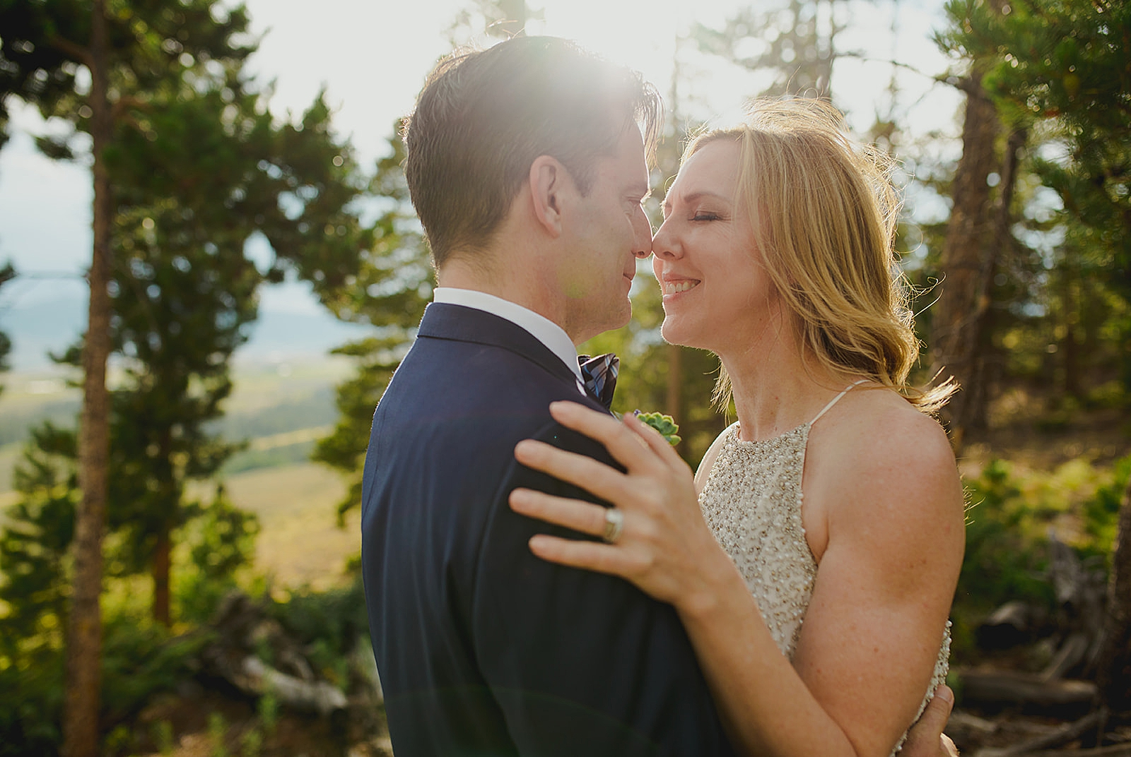 Couple embracing in forest photo by Denver wedding photographer Matthew Speck